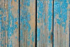 与破旧的蓝色油漆的老木纹理 库存图片
