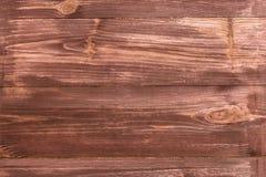 与黑暗的涂层的木头 免版税库存照片