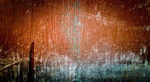 与黑暗的角落的明亮的棕色背景 老被绘的plywoo的纹理 库存图片