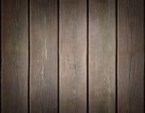 与黑暗的边缘的被风化的木板条背景 库存照片