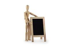 与黑板的木钝汉 库存照片