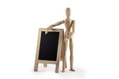 与黑板的木钝汉 免版税库存图片