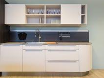 与水槽的好的小米黄厨房kitchenet 库存照片