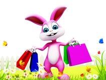 与购物袋的复活节兔子 免版税库存图片