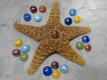 与玻璃珠的海星 库存照片