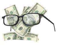 与玻璃的金钱 免版税库存图片