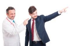 与医生的友好的队或军医和商人 免版税库存图片