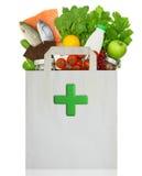与医疗绿色十字架的纸袋 免版税库存照片