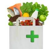 与医疗绿色十字架的纸袋 免版税图库摄影