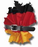 与紧的传送带的德国旗子 库存照片