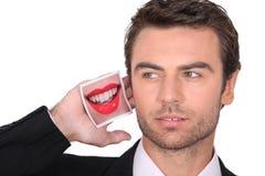 与嘴的图片的商人 免版税库存图片
