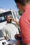 与他的工友的卡车司机 免版税库存照片