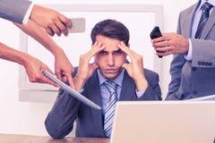 与头的担心的商人在手上 免版税库存照片