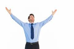 与他的被举的胳膊的欢呼的商人  免版税图库摄影