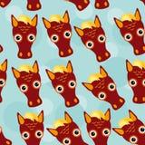 与滑稽的逗人喜爱的动物面孔的马无缝的样式在蓝色bac 库存图片