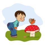 与滑稽的鸟的小男孩谈话 免版税库存图片