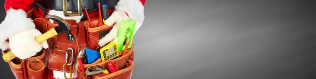 与建筑工具的圣诞老人 免版税库存图片