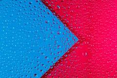 与水箭头和滴的抽象背景  图库摄影