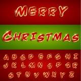 与贴纸样式的圣诞快乐按字母顺序的字体 图库摄影