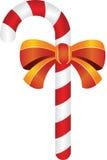 与黄色丝带的圣诞节糖果 免版税库存照片