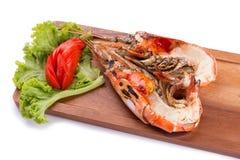 与黄色乳脂状的油脂的烤巨型河虾在头 免版税库存照片