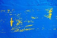 与黄色和蓝色颜色的被绘的木纹理 免版税库存图片