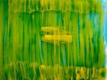 与绿色和黄色油漆的混乱背景 图库摄影