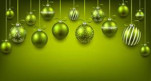 与绿色圣诞节球的弧背景 库存照片