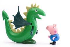 与绿色恐龙的乔治猪 免版税图库摄影