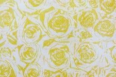 与黄色玫瑰纹理纸的样式 库存图片