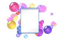 与黄色球形和泡影的空的书在背景 库存图片
