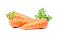 与绿色的三棵红萝卜 免版税库存照片