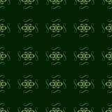 与绿色的无缝的装饰品样式在深绿背景 库存照片