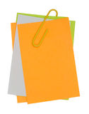 与黄色纸夹的多颜色笔记 库存图片