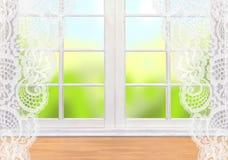 与绿色自然的白色窗口在背景 库存图片