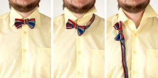 与黄色衬衣特写镜头的五颜六色的镶边蝶形领结 免版税库存照片