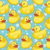 与黄色鸭子的无缝的样式 免版税库存照片