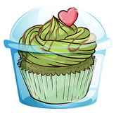 与绿色结冰和桃红色心脏的一块杯形蛋糕 免版税库存照片