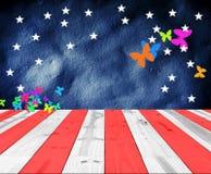 与蝴蝶形状的美国颜色背景的 库存照片