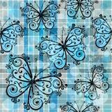 与蝴蝶的方格的无缝的样式 图库摄影