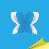 与蝴蝶的蓝纸背景 库存照片