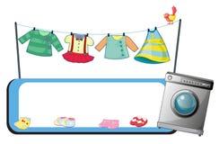 与洗衣机和衣裳的一块空的模板 库存图片