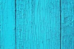 与破裂和削皮油漆的老木表面 免版税库存图片
