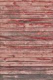 与破裂的颜色油漆的老红色破旧的木板条 库存图片
