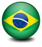 与巴西的旗子的一个球 库存图片