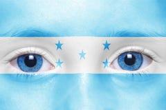 与洪都拉斯旗子的面孔 库存照片