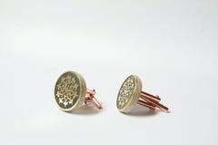 与黄铜蚀刻的手工制造袖扣 免版税库存照片