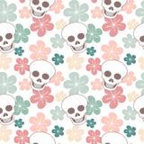 与头骨和花的逗人喜爱的五颜六色的无缝的传染媒介样式背景例证 免版税库存图片