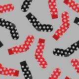 与头骨无缝的样式的黑和红色袜子 免版税图库摄影