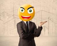 与兴高采烈的面孔的商人 免版税库存图片